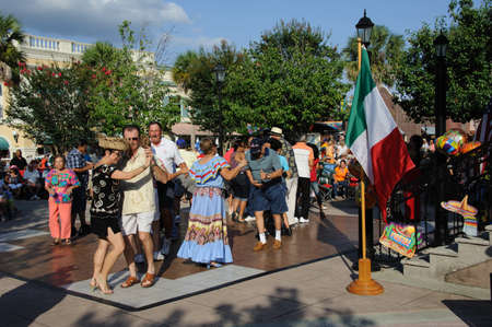 square dancing: Residents of The Villages in Florida USA dancing in the town square during the Cinco De Mayo festival