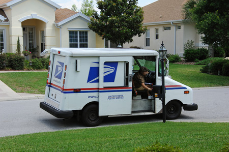 united states postal service: United States Postal Service van on a residential complex Florida USA Mail lady collecting the mail from the mailbox