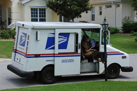 united states postal service: United States Postal Service van on a residential complex Florida USA Mail lady delivering the mail to the mailbox