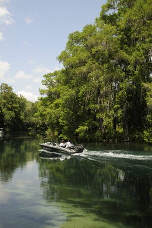 Javelin powerboat cruising on the Rainbow River at Dunnellon in Marion County Florida USA