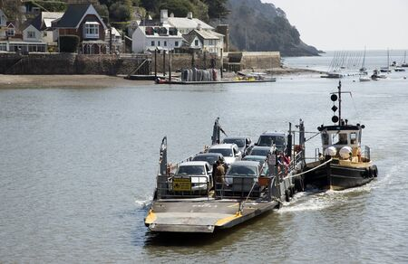 off ramp: Car and passenger ferry on the River Dart Devon England UK