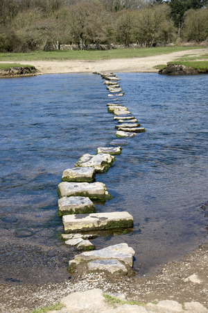 Stepping stones across the River Ogmore in South Wales UK Archivio Fotografico