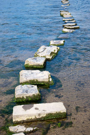 stepping: Stepping stones across the River Ogmore in South Wales UK Stock Photo