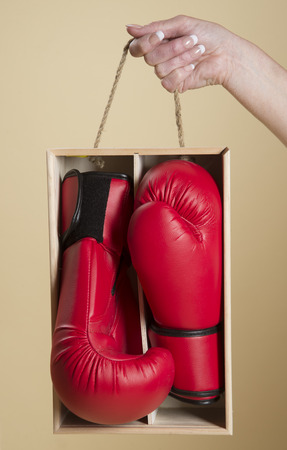 boxed: Pair of red boxing gloves in a wooden box
