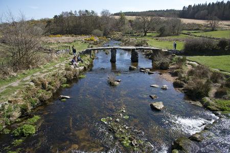 devon: Ancient Clapper bridge at Postbrige on Dartmoor Devon UK