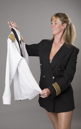 getting dressed: Woman officer getting dressed into uniform