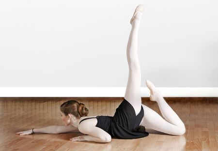 limbering: Young ballet dancer working out in the studio Stock Photo