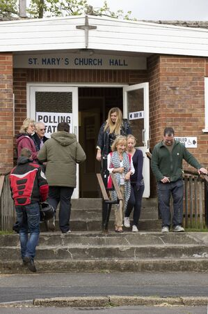 voters: Voters at the Polling Station within St Pauls Church Hall in Kings Worthy Winchester Hampshire England UK Editorial