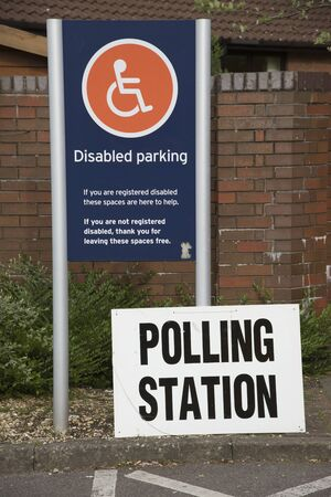 polling: Polling Station notice on a disabled persons parking bay. Winchester Hampshire UK Stock Photo