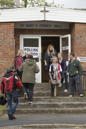 worthy: Voters at the Polling Station within St Pauls Church Hall in Kings Worthy Winchester Hampshire England UK Editorial