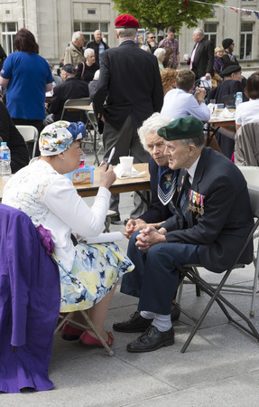 ve: VE Day 70th Anniversary Party in the Guildhall Square Southampton UK 09 May 2015 A Royal Navy Commando veteran enjoying the party