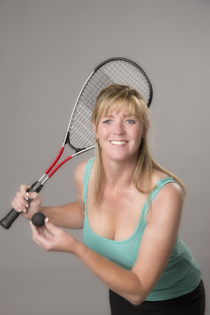 Raquet: Female squash player with raquet and ball