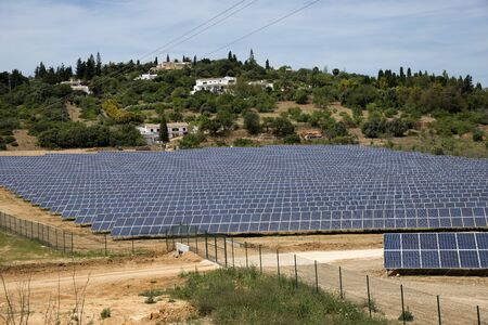 portugal agriculture: Commercial solar panels in a countryside area. Portugal Europe