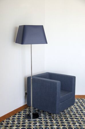 lamp shade: Floor lamp with a blue shade and matching chair