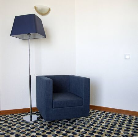 easy chair: Floor lamp with a blue shade and matching chair