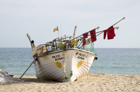 armacao: Fishing boat on the beach at Armacao de Pera Portugal Editorial