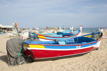 armacao: Colorful fishing boats on the fishermans beach at Armacao de Pera Portugal Editorial