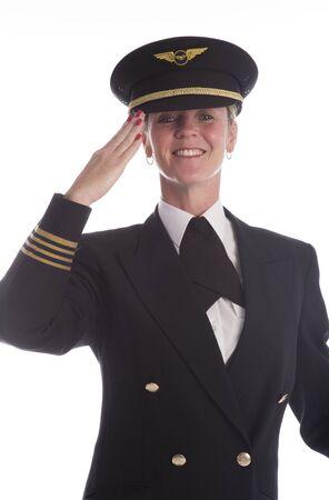saluting: Senior airline pilot in uniform saluting American style Stock Photo