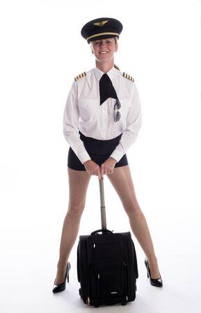 pull along: Female senior airline officer in uniform and flight bag