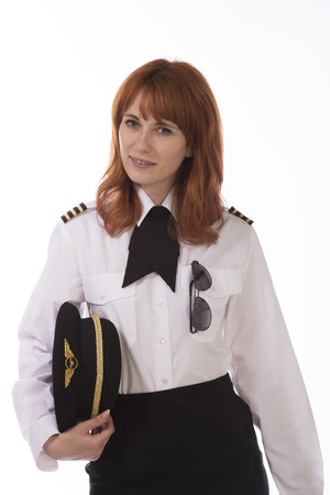Young female airline first officer in uniform Stock Photo