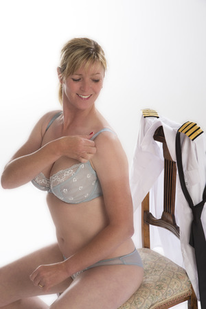 airline pilot: Female airline crew member getting ready for duty