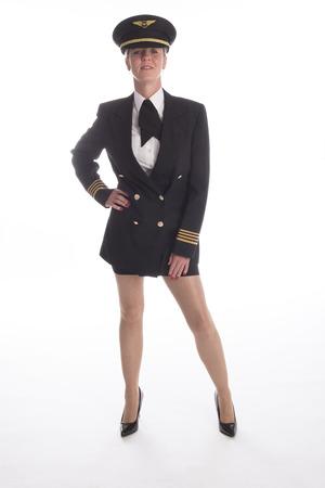 falda corta: Atractivo de pie piloto de l�nea a�rea femenina en falda corta