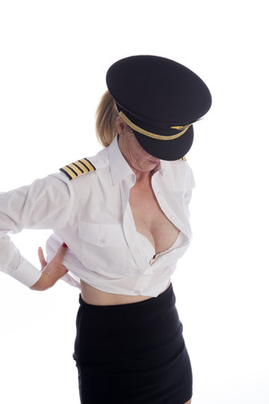 Attractive female airline pilot getting dressed