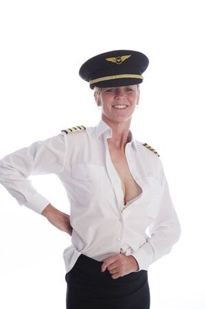 getting dressed: Attractive female airline pilot getting dressed