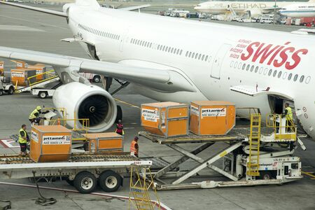 stowing: Cargo handling Containers being stowed in the hold of a Airbus A330 aircraft at JFK USA