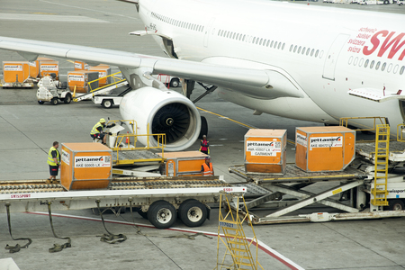 Cargo handling Containers being stowed in the hold of a Airbus A330 aircraft at JFK USA