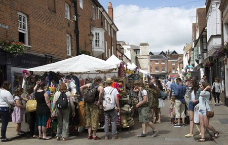 traders: Market traders on The Square Winchester UK during the annual Hat Fair