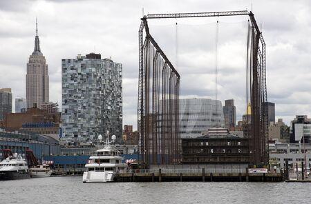driving range: Golf driving range enclosed in giant net on River Hudson New York USA