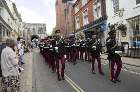 strret: Marching officers and men Kings Royal Hussars during the Freedom of Entry parade in Winchester England. The event celebrates 300th anniversary of the regiment. The regiment marching in the High Strret past Westgate.