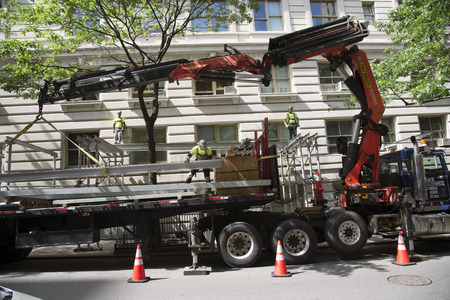 girders: Dismantling and loading scaffolding girders onto a truck New York USA Editorial