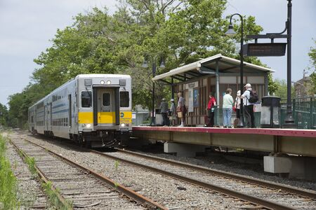 long island: MTA Long island Railroad passenger train approaching Westhampton Station USA