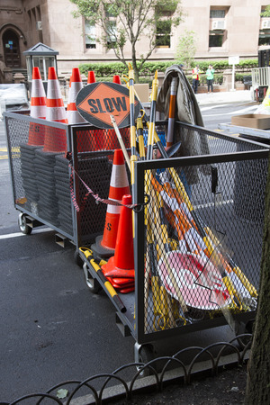 storage bin: Roadside storage of cones stop and slow sign boards Stock Photo