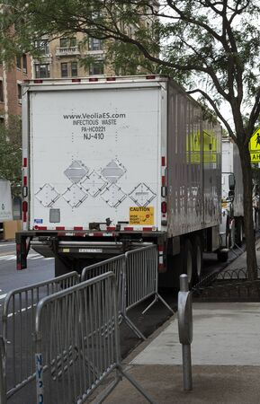 managing waste: An infectious waste collecting truck on the roadside, New York, USA