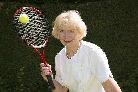oap: Elderly woman playing tennis