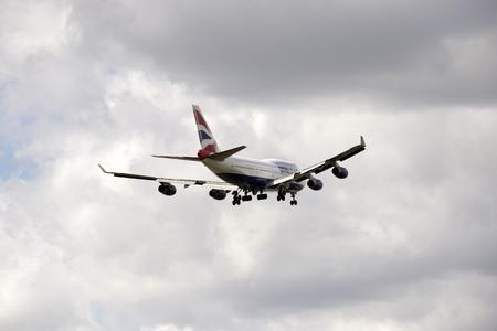 aeronautics: Boeing 747 jet preparing to land wheels down on final approach Editorial