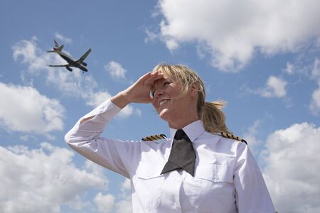 aircrew: Portrait of a pilot with a passenger jet in the sky