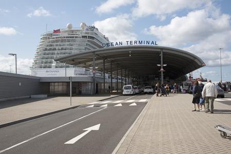 liner transportation: Cruise ship alongside Ocean terminal and passengers arriving Southampton UK