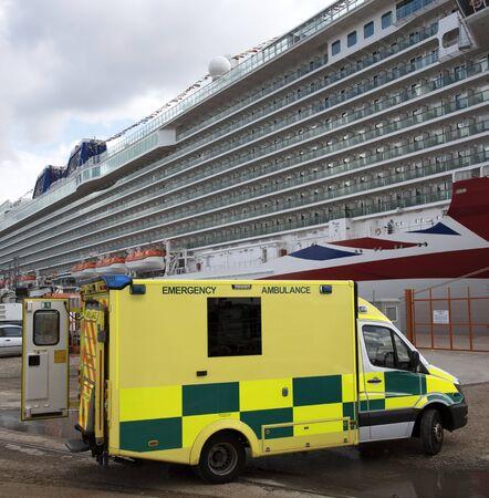 alongside: Emergency ambulance alongside a cruise ship