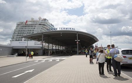 alongside: Cruise ship alongside Ocean terminal and passengers arriving Southampton UK