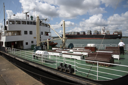 ss: SS Shieldhall main deck and a container carrier on Southampton Water UK Editorial