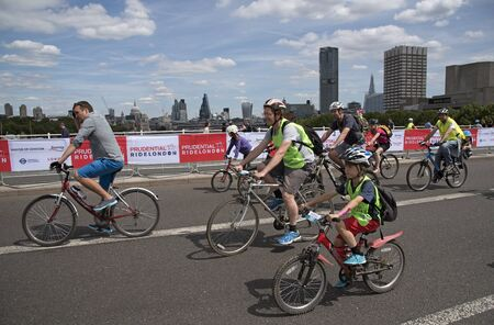 prudential: Action during the Prudential RideLondon Freecycle event in London UK at the weekend. Cyclists seen here crossing Waterloo Bridge. Editorial