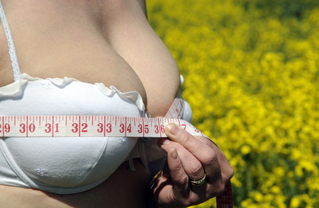 cleavage: Womans bust mesurement being checked Stock Photo