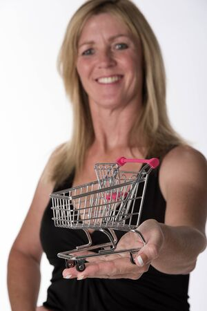 chariot supermarch�: Woman holding tiny supermarket trolley