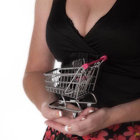 supermarket trolley: Woman holding tiny supermarket trolley