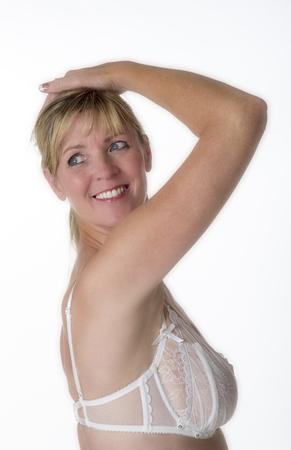 looking over: Woman in underwear looking over her shoulder