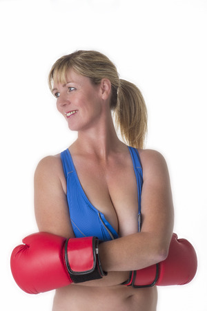 Portrait of a female boxer in a sports bra and red boxing gloves Stock Photo